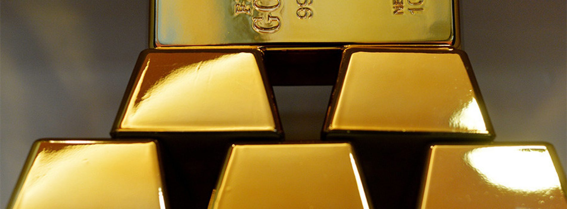 IMF Downgrades Economic Outlook and Boosts Gold Prices