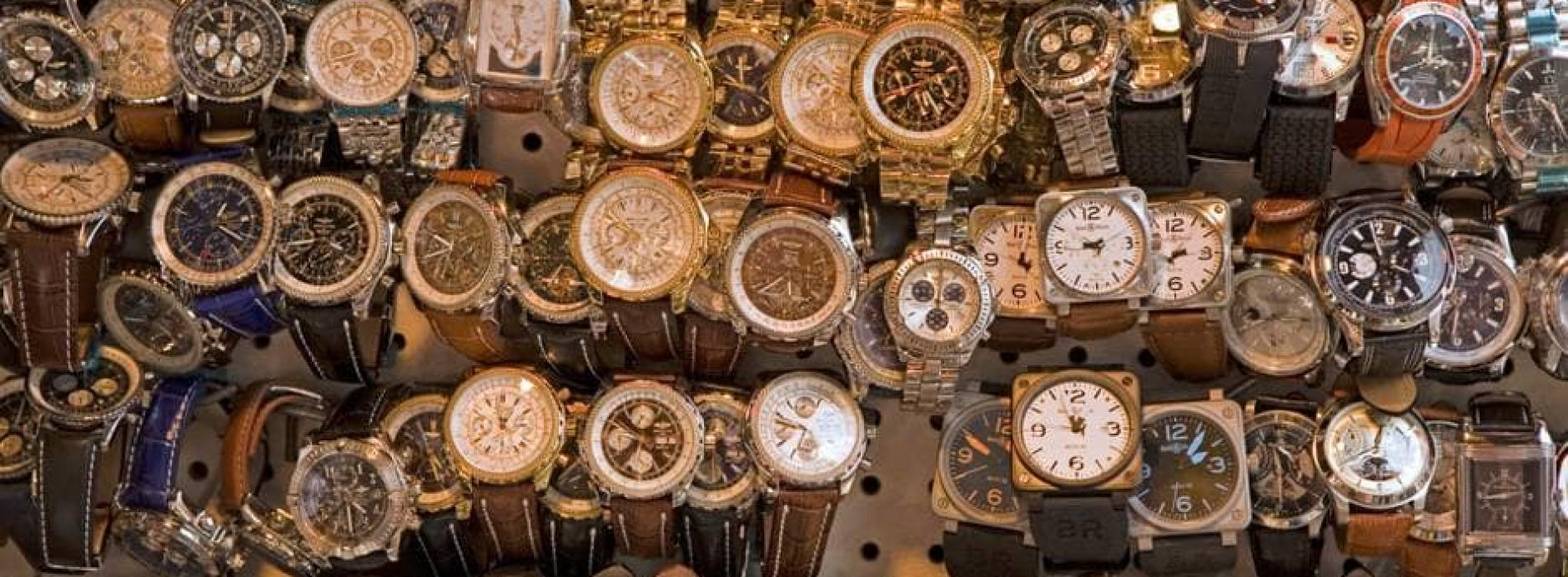 .Cons and of counterfeit watches